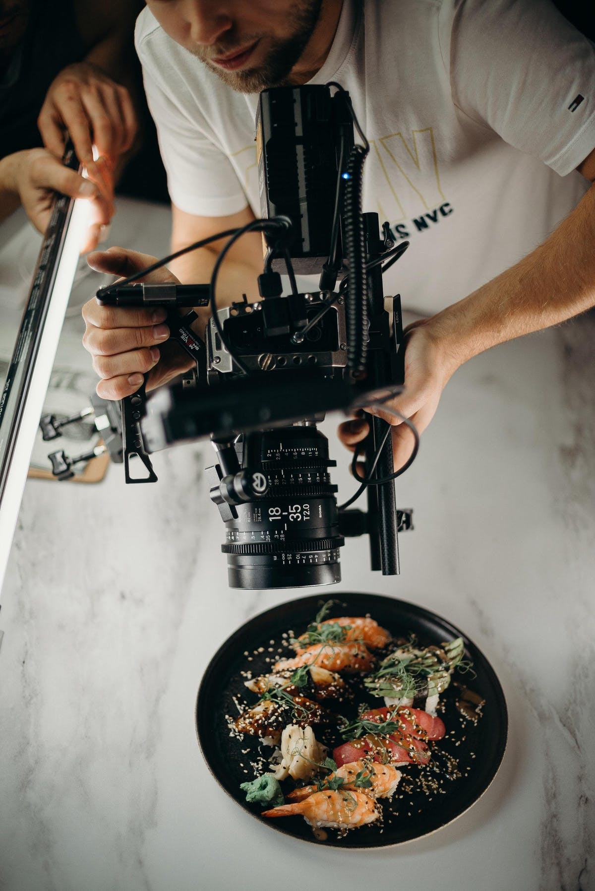Man using video camera pointing on food on plate 3298603